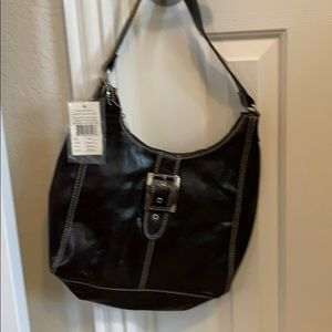Woman's d'margeaux leather handbag, NWT